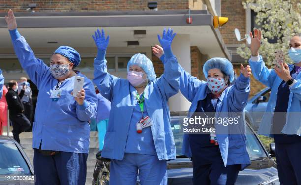 Doctors nurses and staff of Carney Hospital watch a driveby parade in their honor saluting their work during the COVID19 pandemic on April 16 2020...