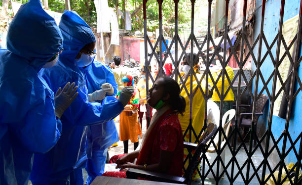IND: Doctors Screening And Collecting Swab Samples Of Slum Residents Following COVID 19 Pandemic