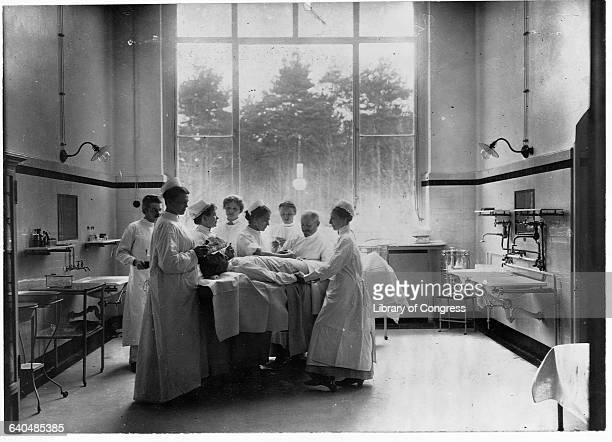 Doctors perform surgery at the Resevelazarett in Beelitz Germany ca 1910s | Location Resevelazarett Beelitz Germany