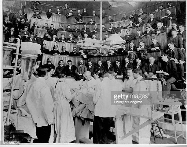 Doctors perform surgery in an operating amphitheatre at Bellevue Hospital in New York City