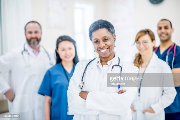 doctors posing together - sports team event stock photos and pictures