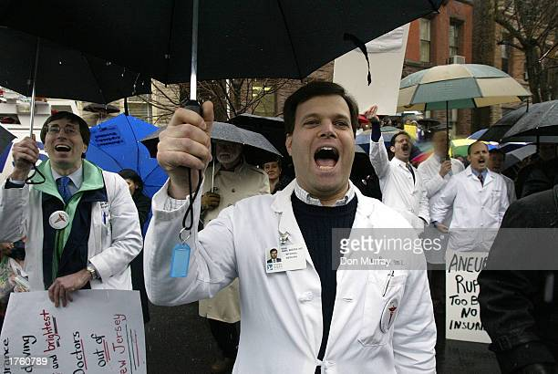 Doctors protest at a rally at the New Jersey Capitol Complex February 4 2003 in Trenton New Jersey About 3000 health care workers attended the...