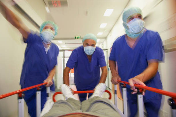 Doctors pushing gurney with patient