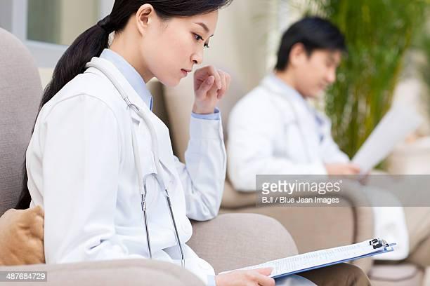 Doctors reading files