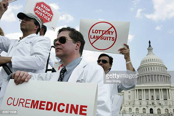 Doctors Rich Iofoedda Chris Gribbin and Niranjan Rao of St Peter's University Hospital in New Brunswick New Jersey hold signs as they join other...