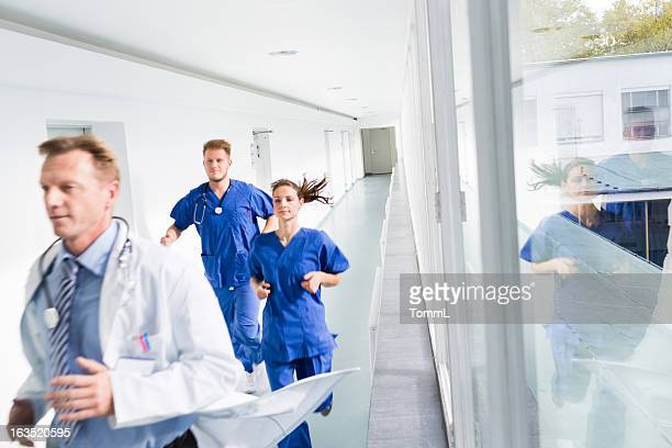Doctors Running in Hospital Corridor