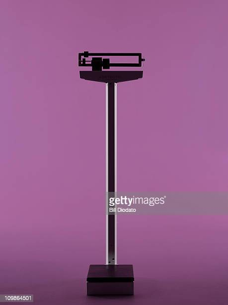 Doctor's Scale on Purple Background