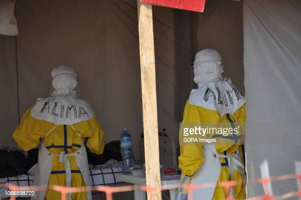 Doctors seen caring for a patient in an ALIMAs isolation cube. Ebola treatment center in Beni, eastern Democratic Republic of Congo, where the...