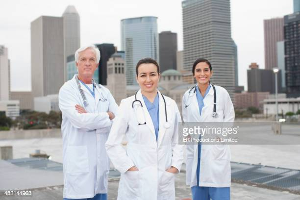 Doctors smiling on urban rooftop