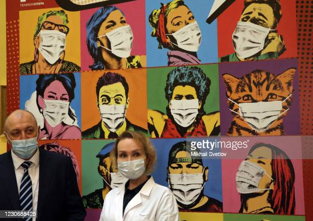 Doctors stand in front of some art as they prepare to vaccinate people against the Coronavirus with Gam-COVID-Vac vaccine at the Helikon Opera on...