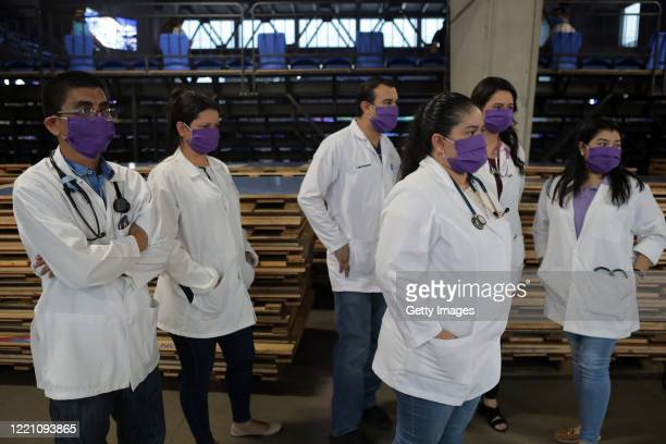 Doctors stand together wearing face masks at Alexis Arguello Sports Center on April 25 2020 in Managua Nicaragua Nicaragua is one of the very few...