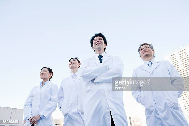Doctors standing outside, low angle view