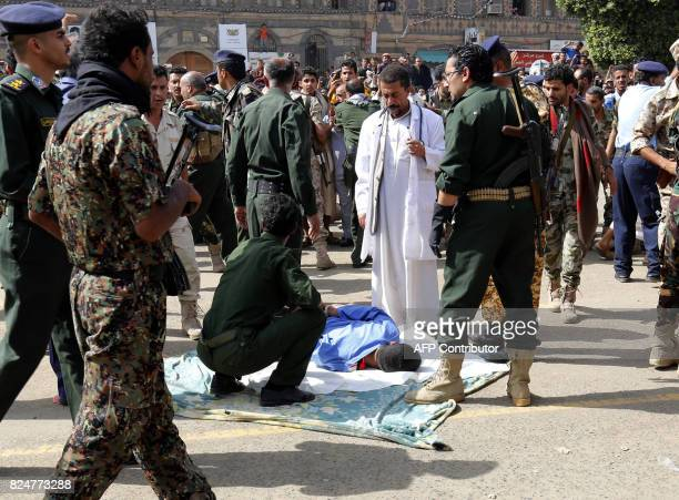 A doctors stands close to Yemeni security forces preparing to execute a man convicted of raping and murdering a threeyearold girl in the Yemeni...