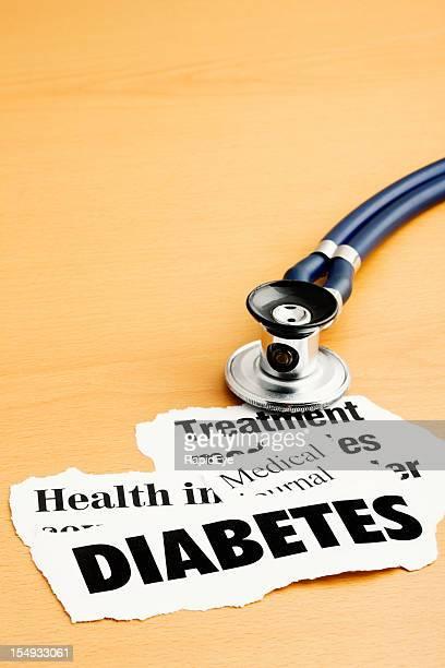 Der arzt Stethoskop sitzt auf Schlagzeilen über diabetes