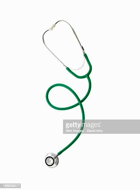 A doctor's stethoscope with green tubing, a conceptual illustration of alternative medicine and wellbeing.