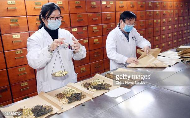 Doctors take a prescription of traditional Chinese herbal medicine at Fuzhou Hospital of Traditional Chinese Medicine amid the coronavirus outbreak...