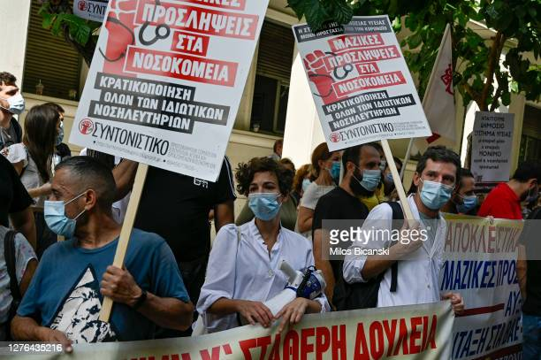 Doctors takes part in a rally during a 24-hour nationwide strike by state hospital workers outside the health ministry in Athens, Thursday, Sept. 24,...