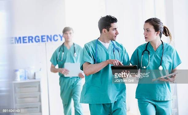 Doctors talking in hospital emergency room