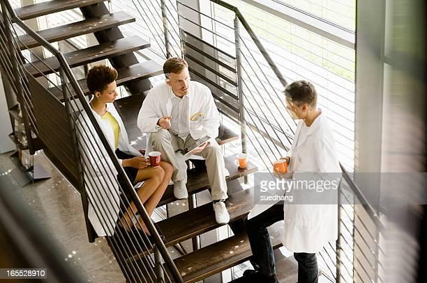 Doctors talking on steps in hospital