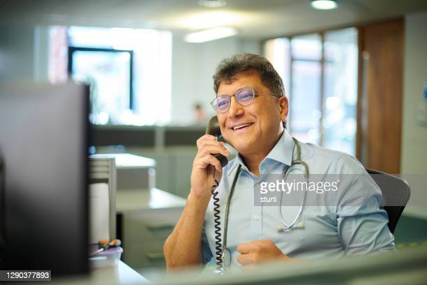 doctor's telemedicine - telephone stock pictures, royalty-free photos & images