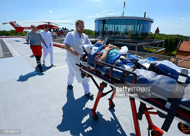 Doctors tend to a man who had fallen and hit his head and delivered with a helicopter at the Unfallkrankenhaus Berlin hospital in Marzahn district on...