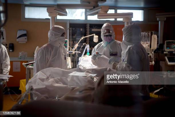 Doctors treat COVID19 patients in an intensive care unit at the third Covid 3 Hospital during the Coronavirus emergency on March 26 in Rome Italy...