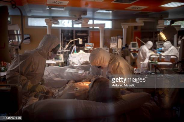 Doctors treat COVID-19 patients in an intensive care unit at the third Covid 3 Hospital during the Coronavirus emergency on March 26 in Rome, Italy....