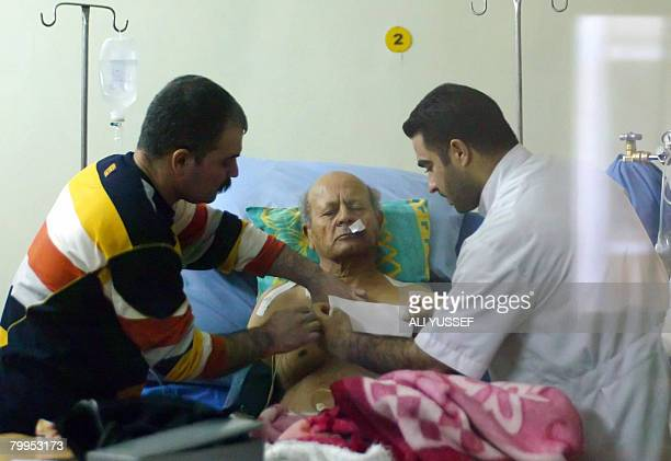Doctors treat Shihab alTimimi head of the Iraqi Journalist Union after he was shot in a driveby shooting in Baghdad on February 23 2008 Timimi was...