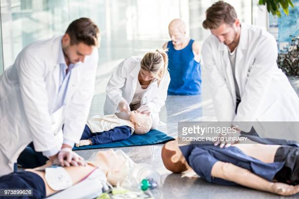 doctors undertaking cpr training - cpr stock photos and pictures