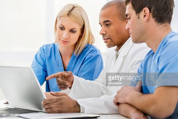 Doctors using computer.