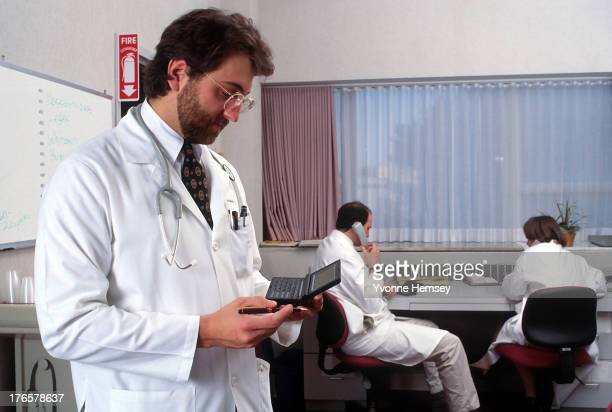 Doctors using the HP 95LX the first MSDOS pocket computer or personal digital assistant by HewlettPackard are photographed December 15 1992 in New...