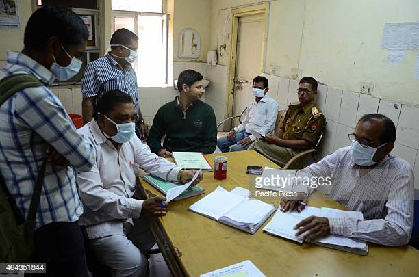Doctors wear mask to prevent from Swine flu while examining patients at Swine flue ward in a hospital