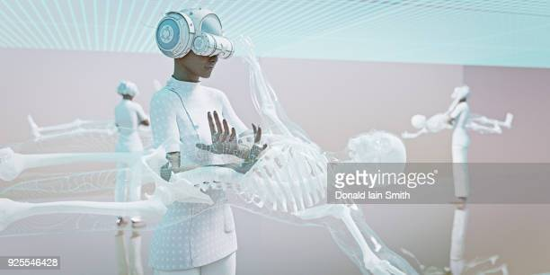 Doctors wearing virtual reality goggles examining skeleton
