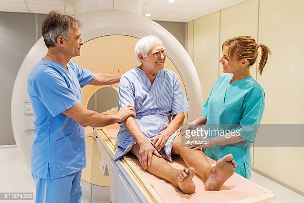 doctors with a patient. - pet scan machine stock pictures, royalty-free photos & images