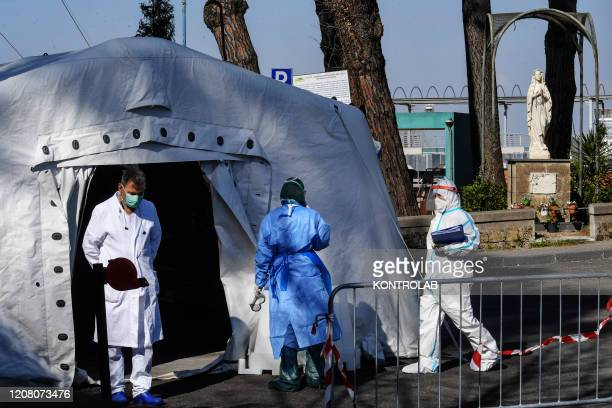 Doctors with masks in the emergency room of the Cotugno hospital for infectious diseases, at the Pre Triage tent for checks and comparison of the...