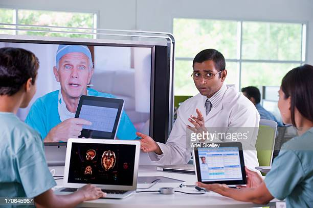 Doctors working in teleconference