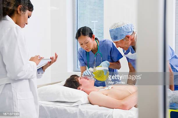 Doctors working on patient in the emergency room