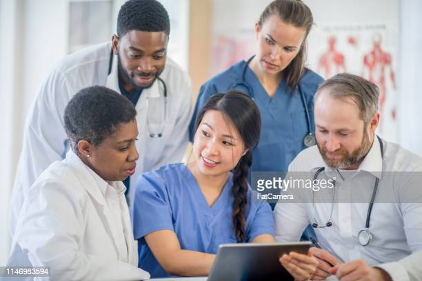 doctors working together - civilian stock pictures, royalty-free photos & images