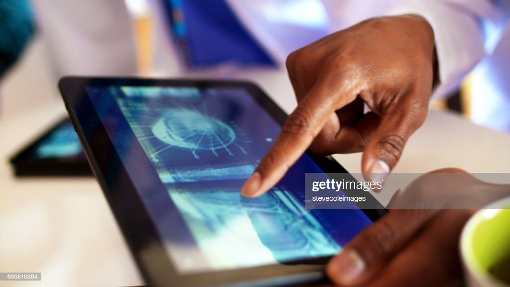 Doctors working with Digital Tablet : Stock Photo