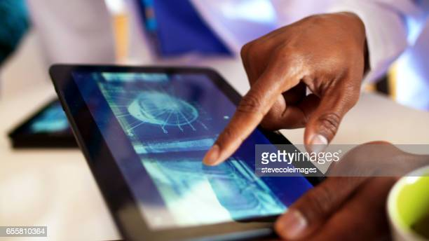 Doctors working with Digital Tablet
