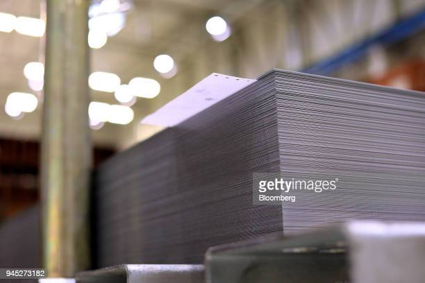 A document sits sandwiched between steel sheets in the metal press shop at the Volkswagen AG factory in Hanover Germany on Thursday April 12 2018 VW...