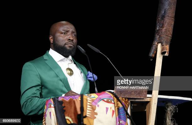 Documenta 14's 'Curator at Large' Cameroonian Bonaventure Soh Bejeng Ndikung speaks during the Documenta 14 art exhibition opening in Kassel central...