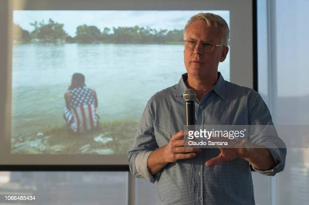 Documentalist photographer John Moore talks during an event to present his book Undocumented on November 29 2018 in Santiago Chile