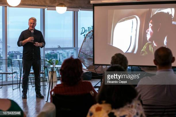 Documentalist photographer John Moore talks during an event to present his book Undocumented at We Work Torre Bellini on November 27 2018 in Buenos...