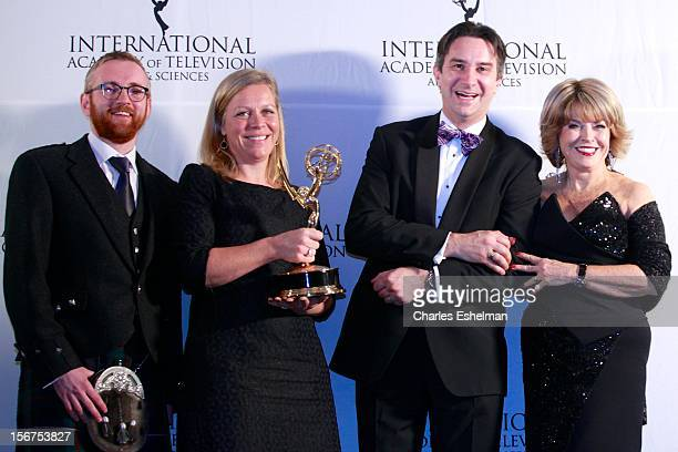 Documentary award winners executive producer Craig Hunter and editor Charlotte Moore guest and presenter Pat Mitchell attend the 40th International...