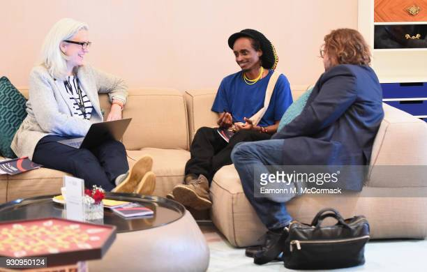 Documentary consultant Joslyn Barnes speaks with director Hajooj Kuka and producer Steven Markovitz during the OneonOne Tutorial Sessions on day four...