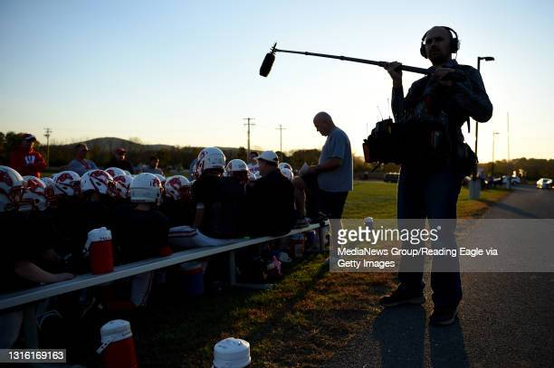 Documentary crew member Jackson Derbish holds a boom as he helps films Timothy Mashburn during Van Reed Midget football practice at Wilson West...