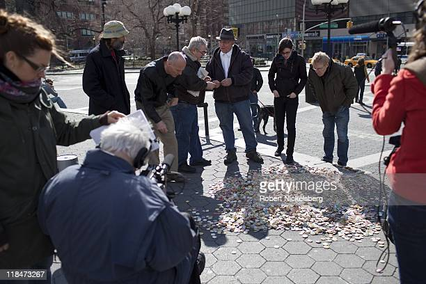 Documentary filmmaker Albert Maysles left shoots a segment of a feature on New York artists March 13 2011 in Union Square Park in the Manhattan...