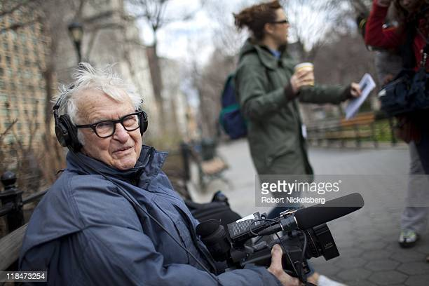 Documentary filmmaker Albert Maysles shoots a segment of a feature on New York artists March 13 2011 in Union Square Park in the Manhattan borough of...