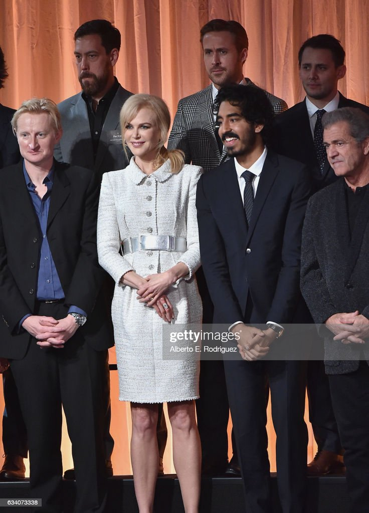 Documentary filmmaker Dan Krauss, actor Ryan Gosling, Lyricists Benj Pasek and (front, L-R) Guy Hendrix Dyas, actress Nicole Kidman, actor Dev Patel and Director Mel Gibson attend the 89th Annual Academy Awards Nominee Luncheon at The Beverly Hilton Hotel on February 6, 2017 in Beverly Hills, California.